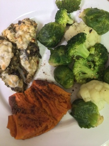 baked pesto chicken with steamed broccoli and cauliflower & a sweet potato with coconut oil and cinnamon. easy and quick college girl dinner!